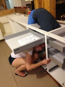 While Andrew was sanding, Amanda & Adrienne were doing yoga/installing rails for the drawers along the island.