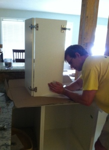 David building doors for the cabinets! (The easiest part of the Ikea cabinet process if you ask me.)