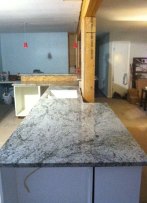 Granite everywhere! (Those cups will come down, I promise.)